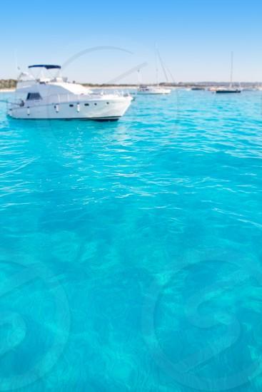 Anchored motorboats in Formentera Illetes beach near Ibiza photo
