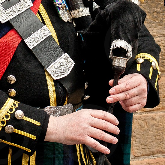 Close up of hands playing the bagpipe photo