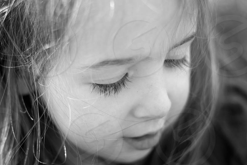 long lashes girl child wild hair photo