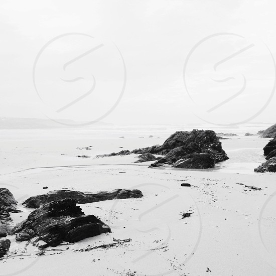 rock formation on seashore photography photo