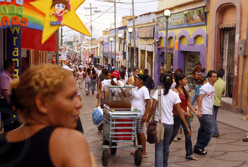 people in a shopping street in the city of Valencia in the west of Venezuela. photo