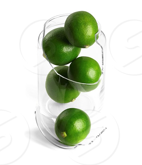 shattered glass jar with lime on white background photo