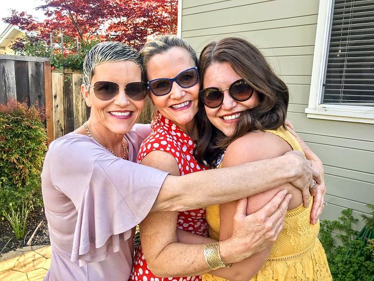 Family group hug embrace smile smiling cuddling aunt mom daughter photo