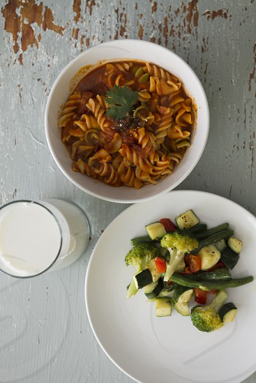 pasta cooked vegetables glass of milk healthy eating organic top view table top bowl dish lunch dinner brunch cooking Italian food photo