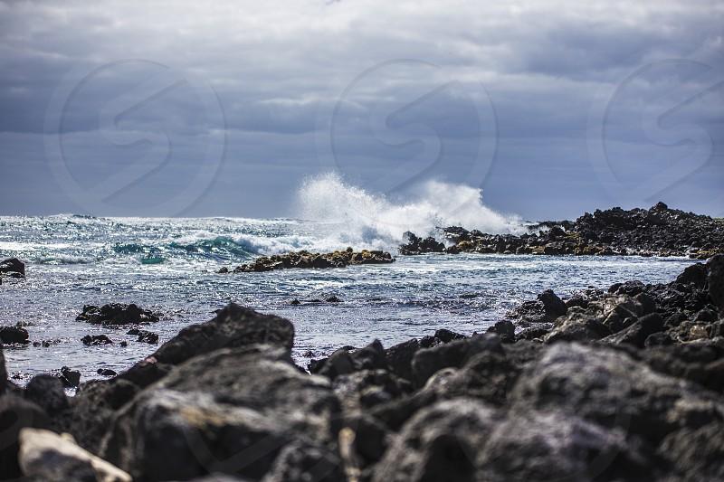 Waves crashing upon the shore photo