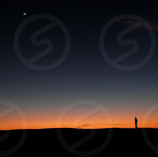 man on a mountain silhouette photo photo