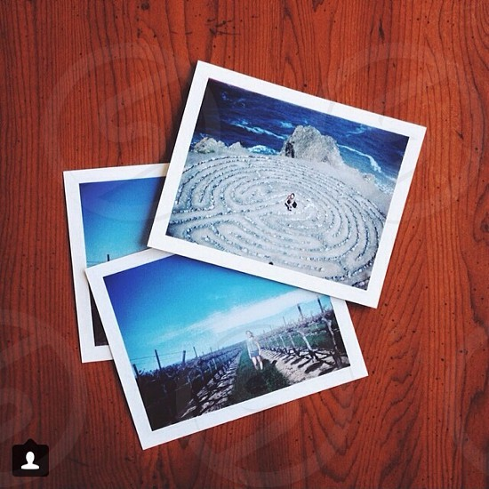 multiple pictures of seas and blue skies on wooden surface photo