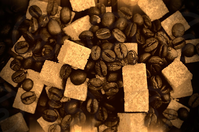Very warm picture of coffee beans background color corrected as old slightly damaged photo in beautiful sepia style. photo
