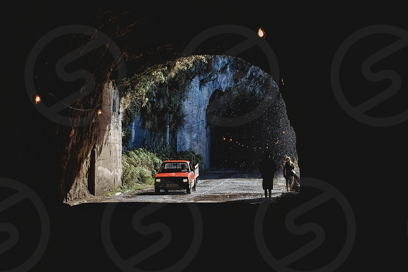 Tunnel lights water drops car people walking shadow light way road  photo