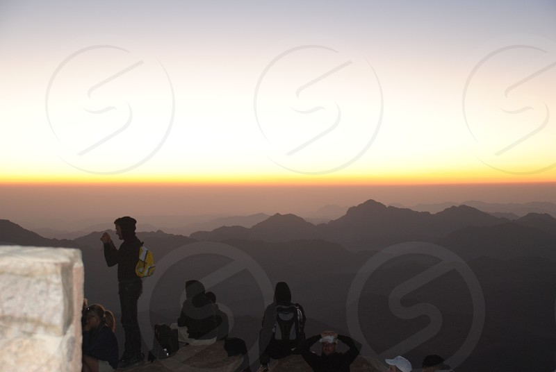 climbers mountain and sunset view  photo