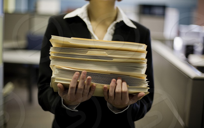 officeworker with file folders photo