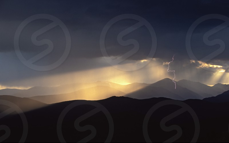 negative space lightning mountains storm clearing god rays golden inspirational mount evans colorado usa weather electrical  photo