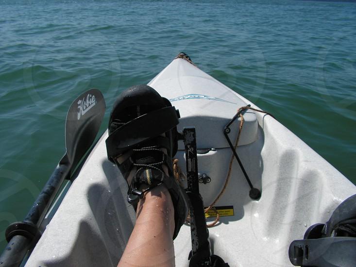My foot pedaling a kayak photo