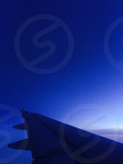 grey aircraft left wing while on flight photo