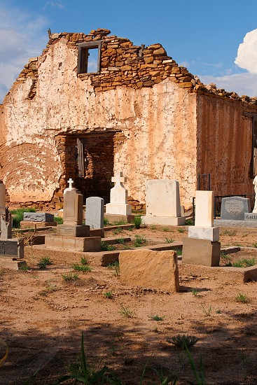Old graveyard in New Mexico. Graves. Stone. Brick. Decay. Southwest. Cowboy. Western. Cross. Christian. Building. Ancient. Dead. Cemetery. Ghost.  photo