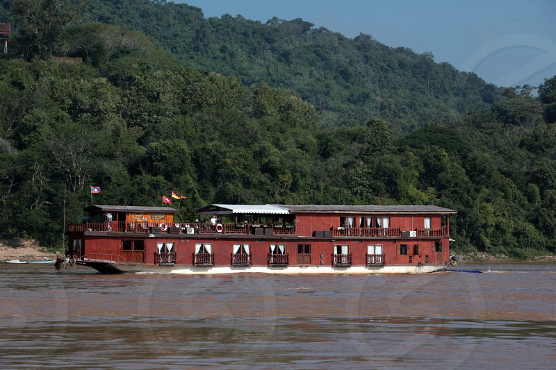 a Hotel cruise Boat on the Mekong River near Luang Prabang in the north of Lao in Souteastasia. photo