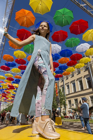Soaring colored umbrellas against a blue sky photo