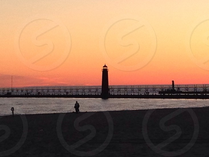 At Grand Haven MI State Park at sunset.  photo