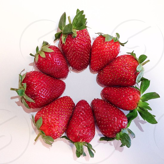9 red strawberries forming a circle photo