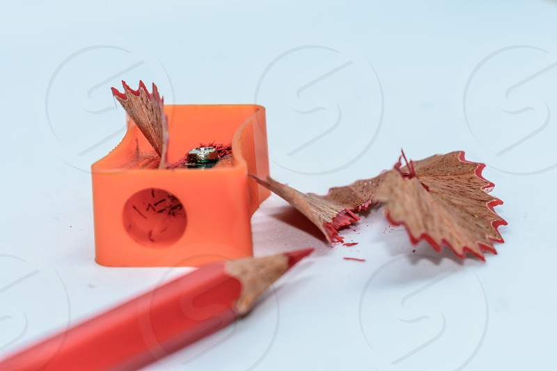 Selective Focus: Color pencil with sharpener shavings on white background photo
