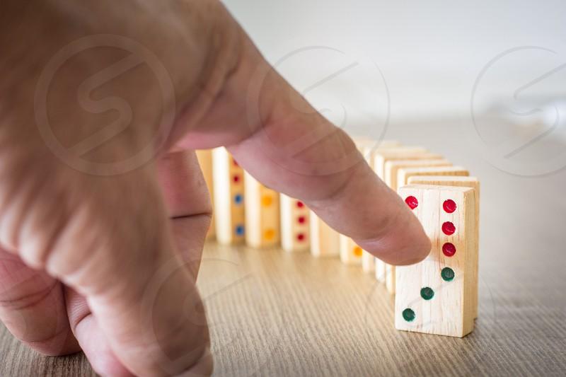 Hand push dominobusiness concept photo