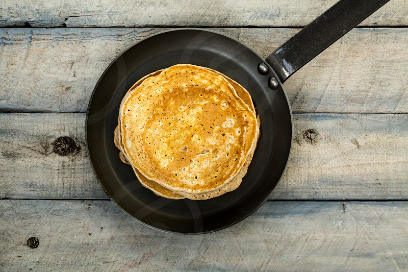 pancakes in pan on wood table photo