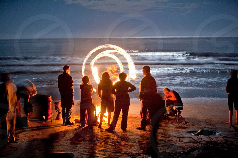 group of people watching fire dancing photo