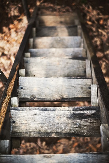 Old wooden staircases looked from above with focus on first step.  photo