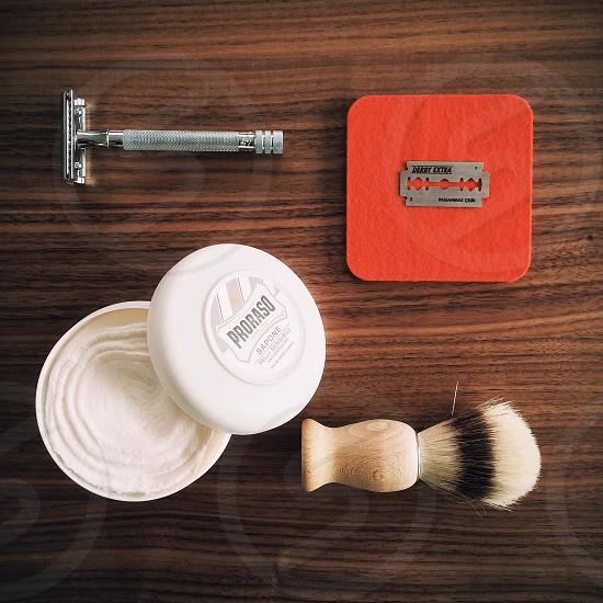 Cutting Edge - Razor tools on fine wood grain photo