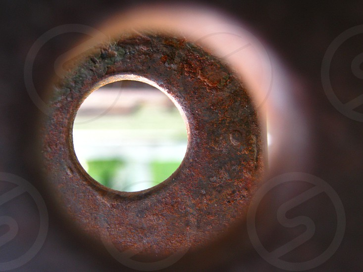 shallow focus photography of rusted brown steel hole photo