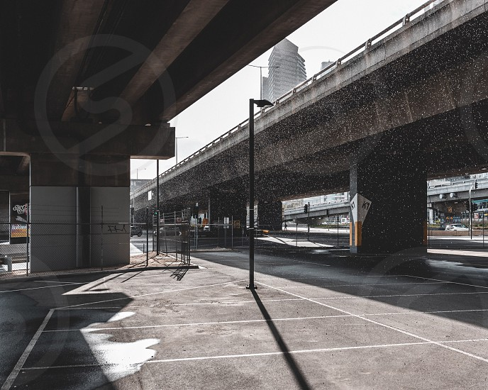 Car park empty space concrete jungle Melbourne concrete pillar south bank spring day light shade freeway overpass empty photo