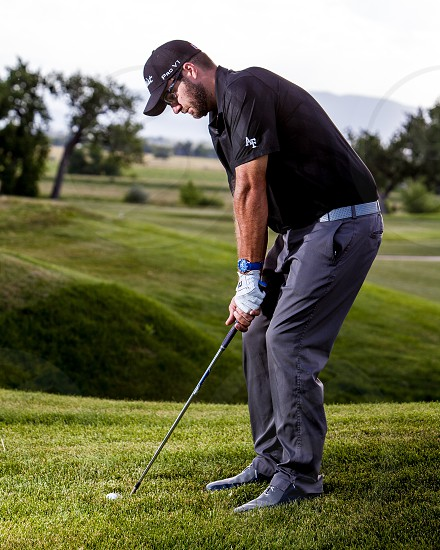 golfer portrait golf green course putt pitch wedge air force af grey greens sport professional swing stance hit ball photo