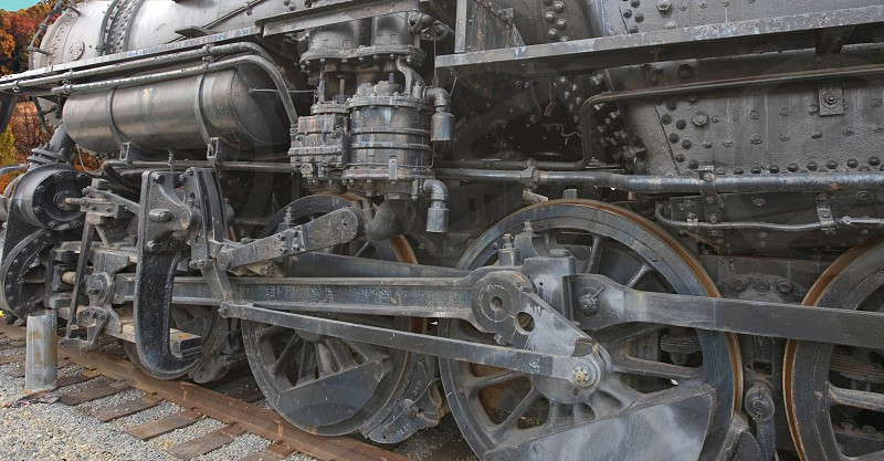 """One of the original """"iron horses""""  Photograph depicts the business portion of the train's power.  The large wheels and heavy metal show the power of this Locomotive. photo"""