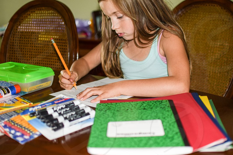 Checking off school supplies list photo