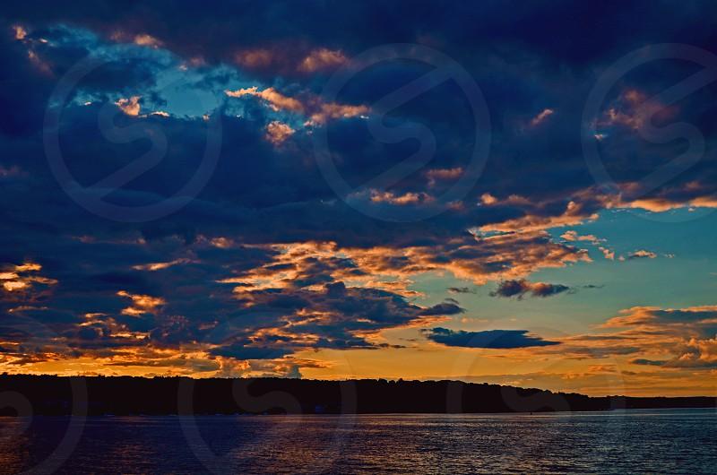 sunset clouds beach water landscape photo