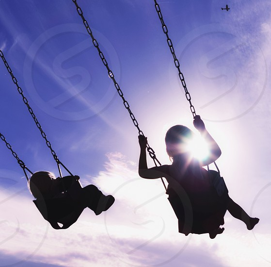 Swinging in the sun  photo