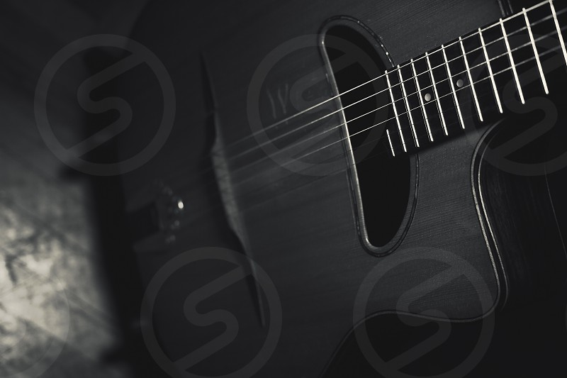 Gypsy acoustic guitar body and neck closeup view. photo