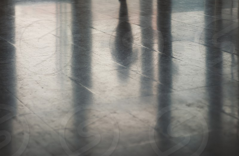 Abstract of a big hall floor details of silhouettes  and reflections.  photo
