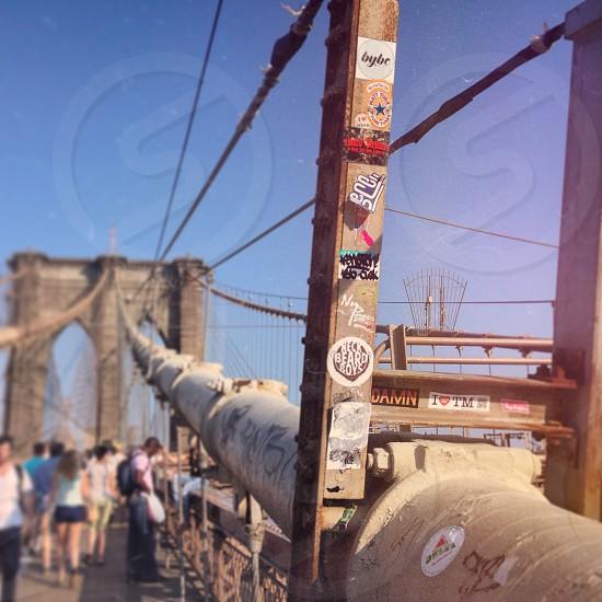 Graffiti and stickers along the Brooklyn Bridge leaving Manhattan. photo