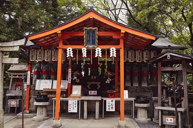 Various shrines along a mountainside hike at Fushimi Inari-Taisha Shrine in Kyoto Japan photo