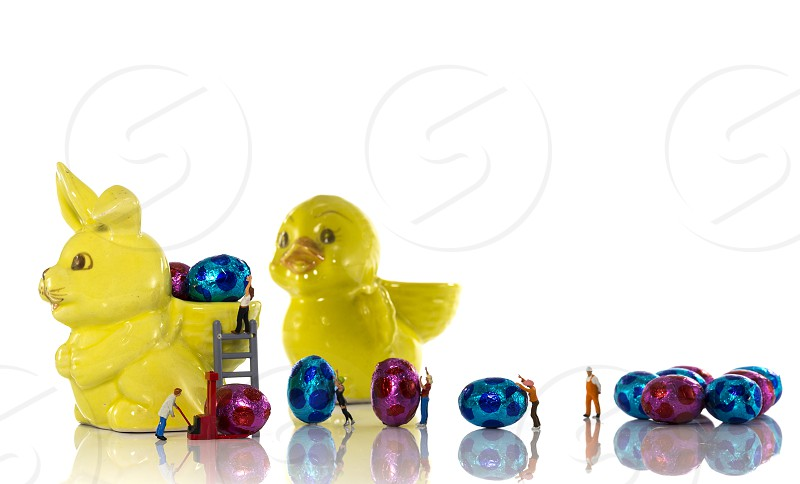Easter bunny is provisioned with new easter eggs photo