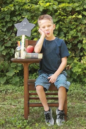 School summer boy son kid grade desk supplies Apple book sit tongue sitting wood vintage human face portrait photo