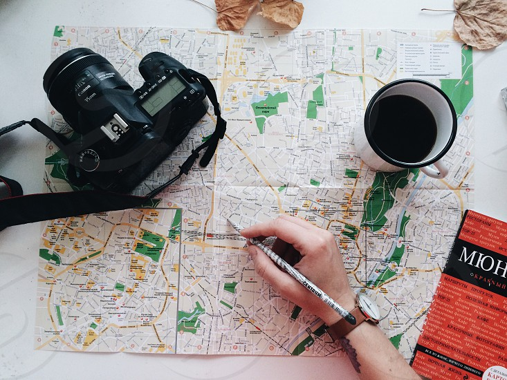 Travel trip map camera preparation adventure planning coffee photo