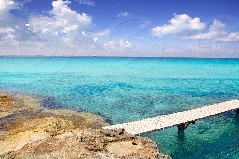 Illetes illetas beach with wooden pier and turquoise sea Formentera Balearic Mediterranean island photo