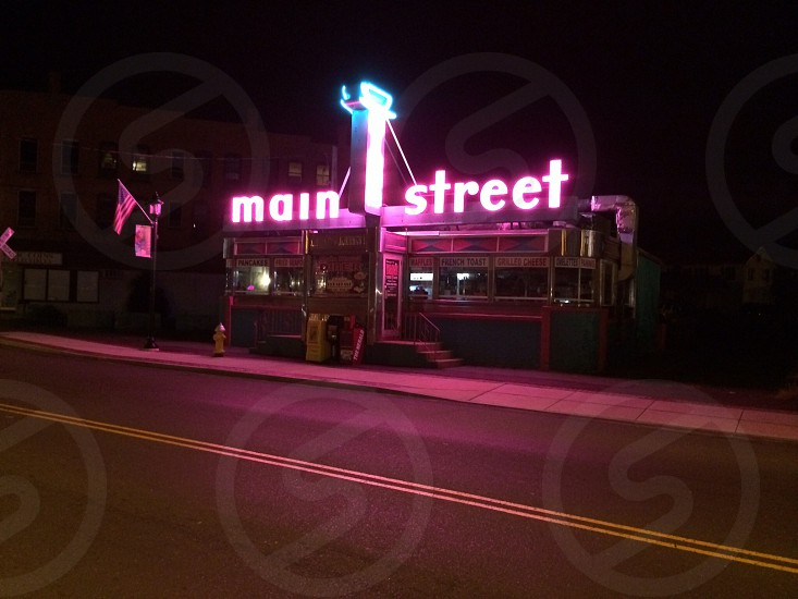 main street signage with pink led light photo