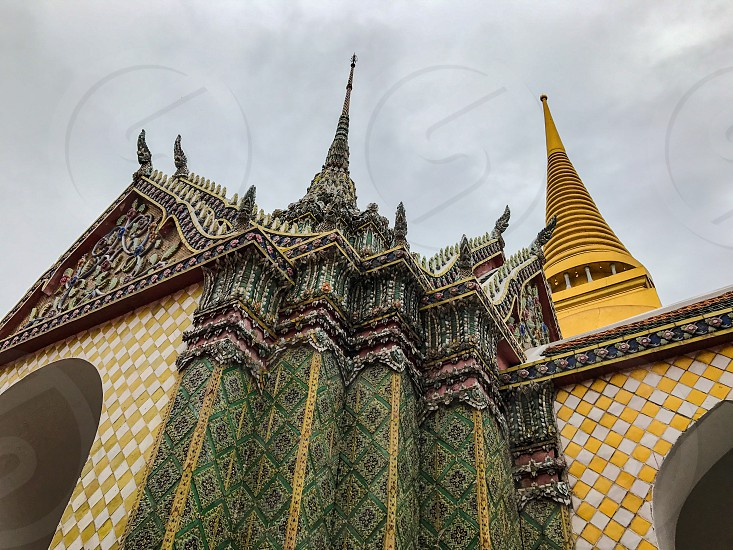 Outdoor day landscape horizontal colour Grand Palace Bangkok Thailand Kingdom royal regal monarch king Asia Asian east eastern Far East gold golden mosaic tiles temple shrine monument attraction spires travel tourism tourist wanderlust architecture ornate decorative photo