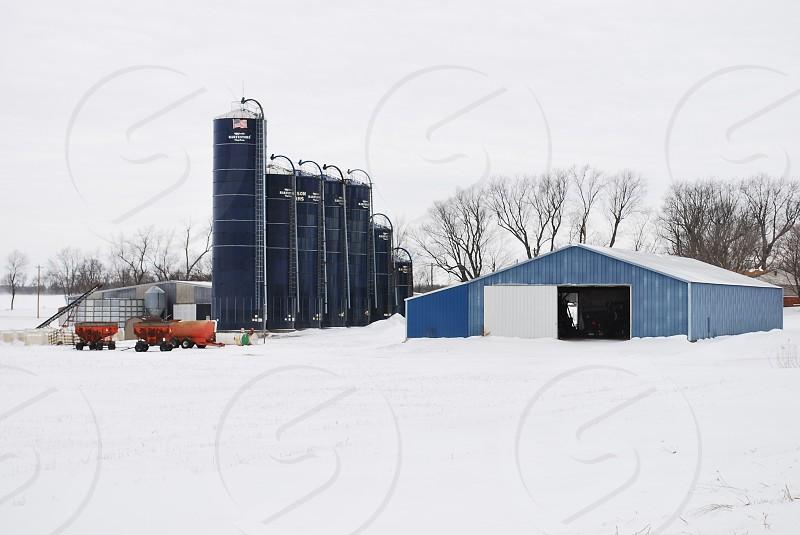 Blue barn in snow photo