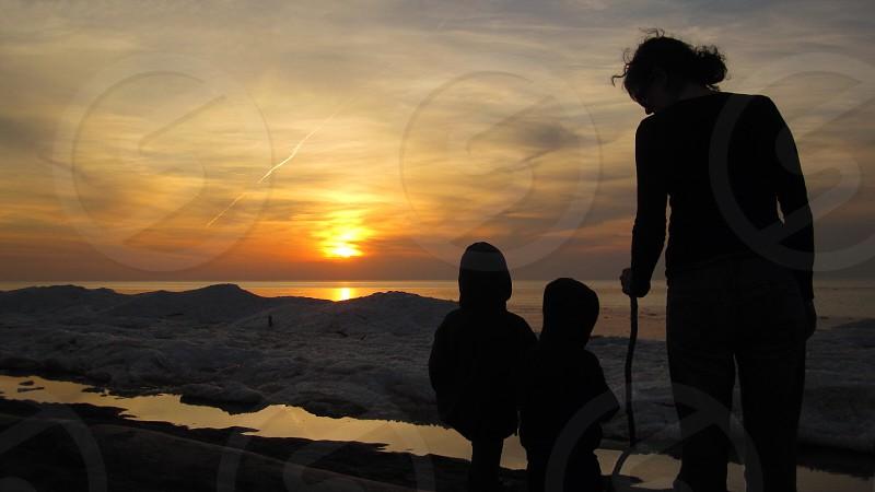 three human silhouette photo