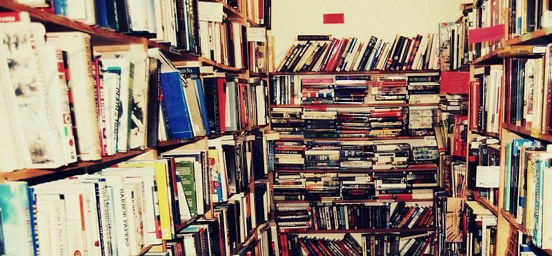 High contrast shot of messy bookshelf  photo