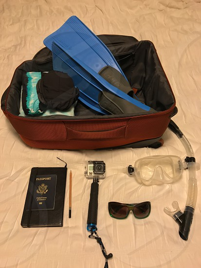 Travel packing travel items adventure planning suitcase traveling snorkel gear photo